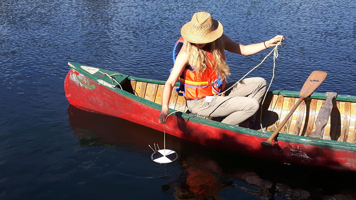 Volunteer Emily Corbett participates in the Lake Partner Program on her lake