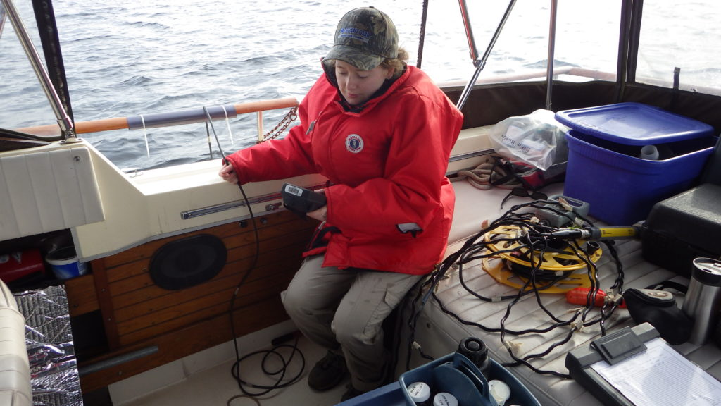 SSEA field crew recording temperature, oxygen and conductivity profiles in Penetanguishene Harbour, Severn Sound